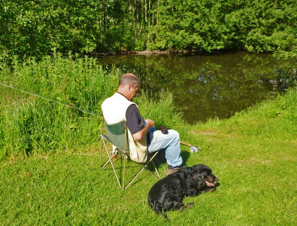 One fisherman and his dog