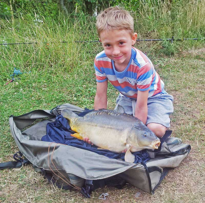 Harley Cole with a carp