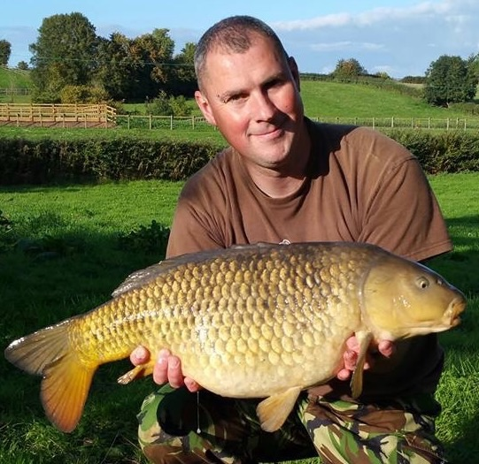 A photo of Chris Fennel with a carp caught at Elton Carp Lakes