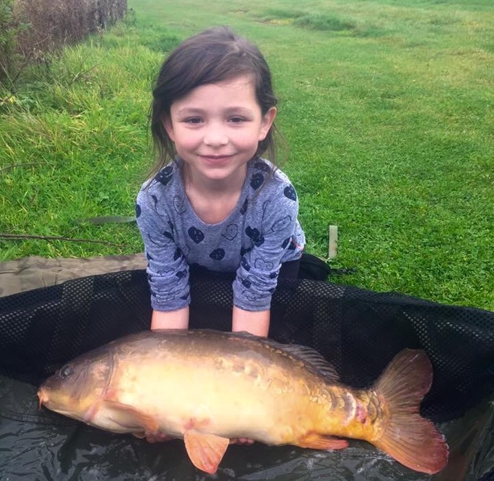 Lee's daughter lands a carp at the Horseshoe lake
