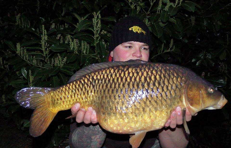 A photo of a carp landed by Andrew Warren taken at night