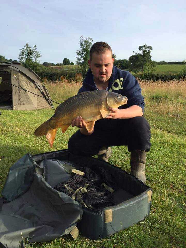 A photo of Darren Rogers with a fine carp
