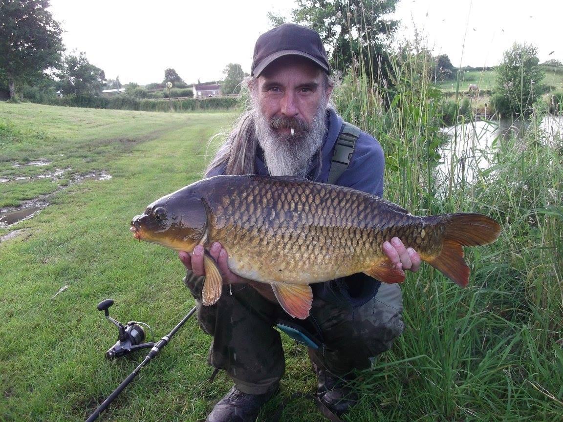 A photo of James Mc Pott with a 14lb 8 oz carp