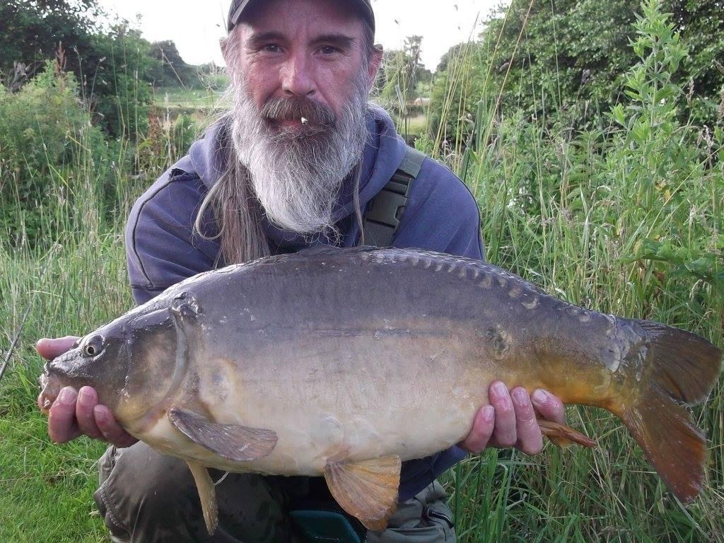 A photo of James McPott with a 14lb 8oz carp.