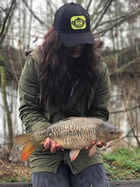 A photo of Arran's 'Mrs' with a lovely carp.