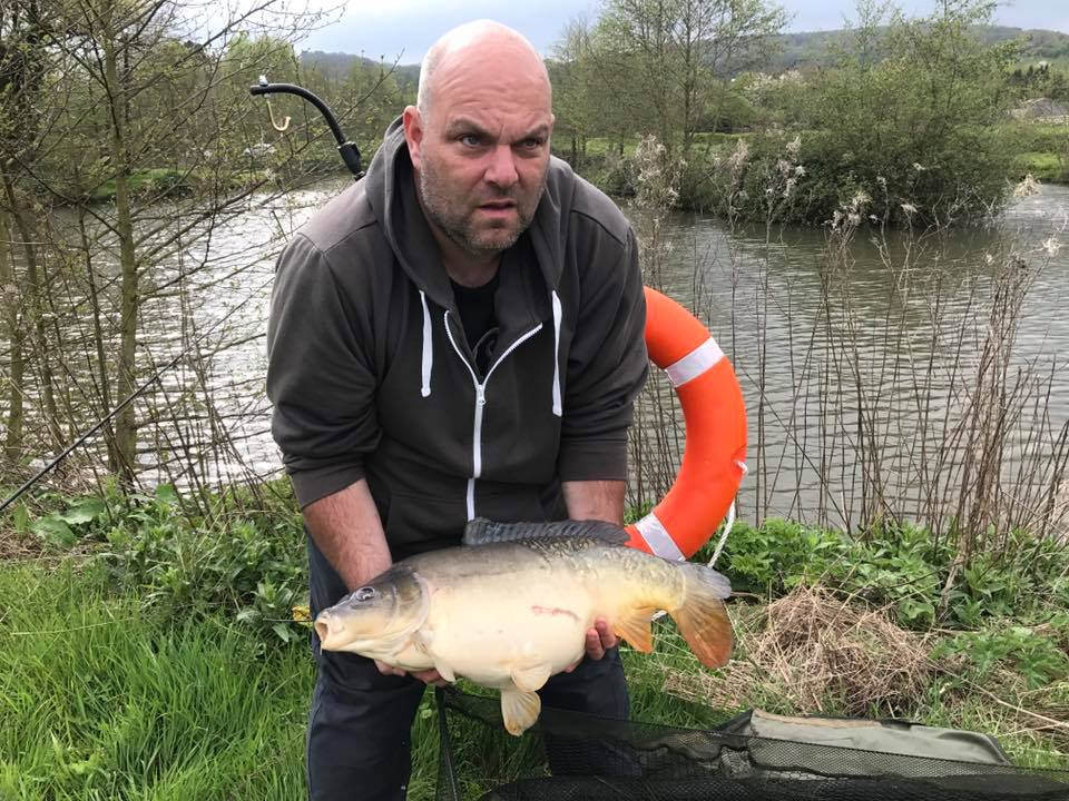 A photo of Adrian with a carp