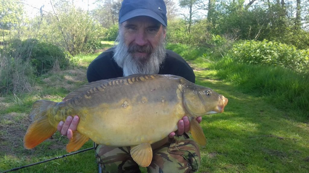 A photo of James with a lovely Mirror carp 13lb 10 oz.