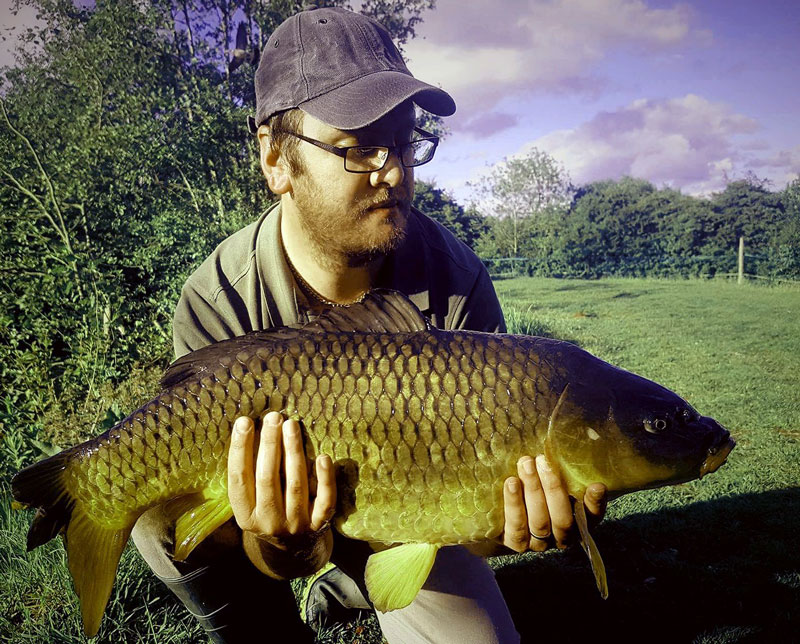 A photo of Alex Simons with an 18lb beauty.