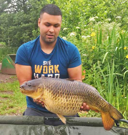 A photo of Adam with a 21lb 5oz common carp from top lake at Elton.