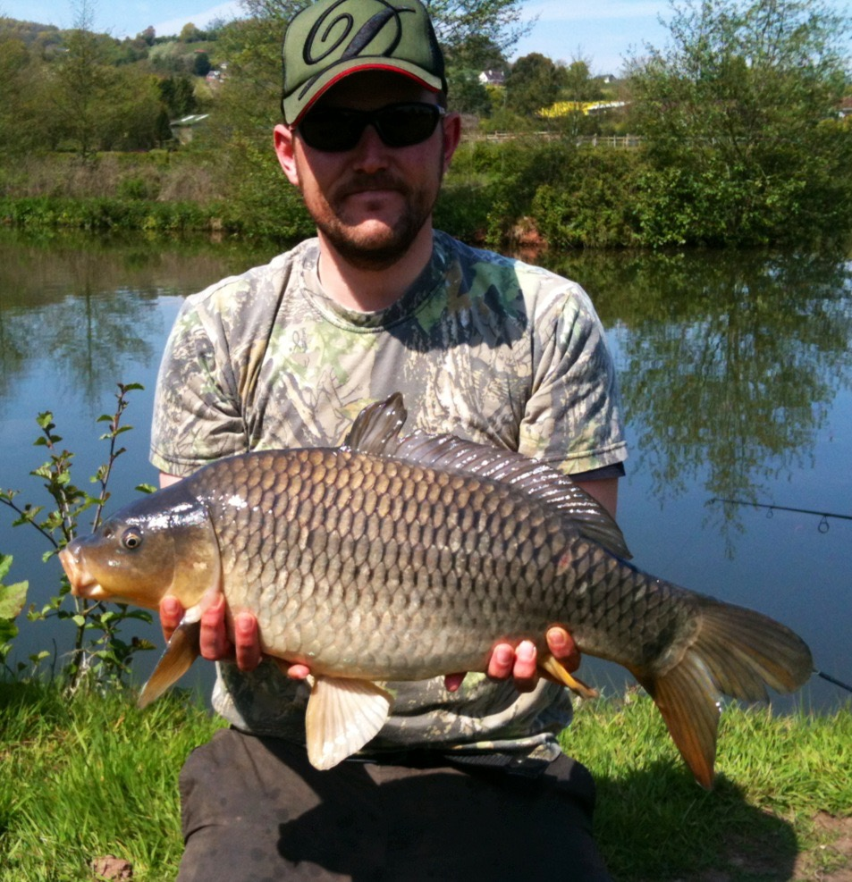 A photo of Danny Robins with a mid double common carp