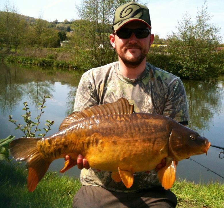 A photo of Danny Robins with a mid double mirror carp