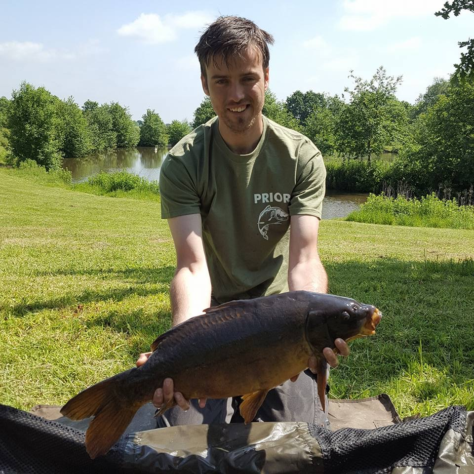 A photo at Elton Carp Lakes showing Chris Prior with a 13lb 7oz leather.