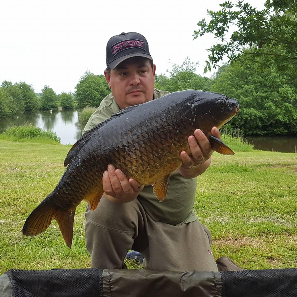 A photo of Ian Gupta with a fine 17 lb carp.
